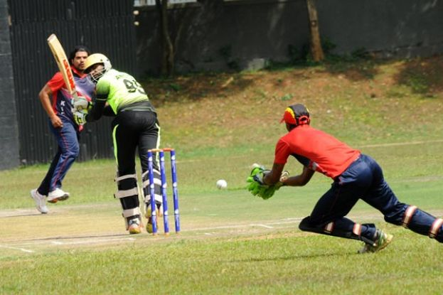 No Challenge.Top order batsman Aneef Mohammed (C) of Challengers plays a delivery from Sharif Suleman (L) as Kampala Institute of Cricket Clubs wicketkeeper Zephaniah Arinaitwe collects in a Division One Jazz Safari National Cricket League at Kyambogo Oval on Sunday. PHOTO BY EDDIE CHICCO