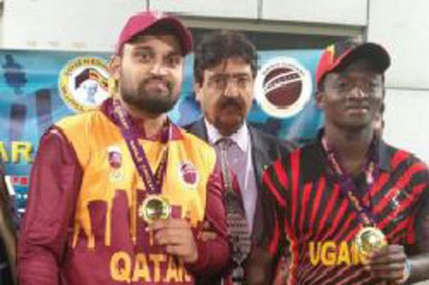 The stars. Joint Man-of-Match winners Simon Ssesaazi of Uganda (right) and Qatar's Tamoor Sajjad show off their medals on Friday at the Asian Town Cricket Stadium in Doha. Uganda won by five runs. PHOTO BY INNOCENT NDAWULA