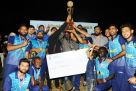Keshwala Boyz receiving their trophy from UCA chairman Ansasiira (C) on Saturday night. PHOTO BY EDDIE CHICCO