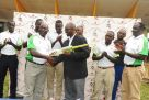 CEO Justine Ligyalingi hands over a bat and ball to new Cricket Cranes coach Tikolo (3rd L). Kamya (L), Ndiko (2nd L), Ogwang (4th L), Isaneez (4th R), Tumusiime (3rd R), Mugalula (2nd R) and Okecho (R) are the other coaches appointed by Uganda Cricket Association. Inset is Tikolo making a point during yesterday's press conference in Lugogo. PHOTO BY EDDIE CHICCO