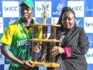 West Africa Pride. Patricia Kambarami (R), the ICC Development Manager for Africa, hands over the winners trophy to Nigeria captain Sylvester Ameh Okpe on Tuesday in Potchefstroom. PHOTO: ICC MEDIA