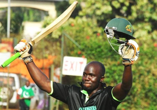 Challengers' Kyobe salutes the crowd after he reached three figures against Nile in Lugogo on Sunday. Photo By Eddie Chicco