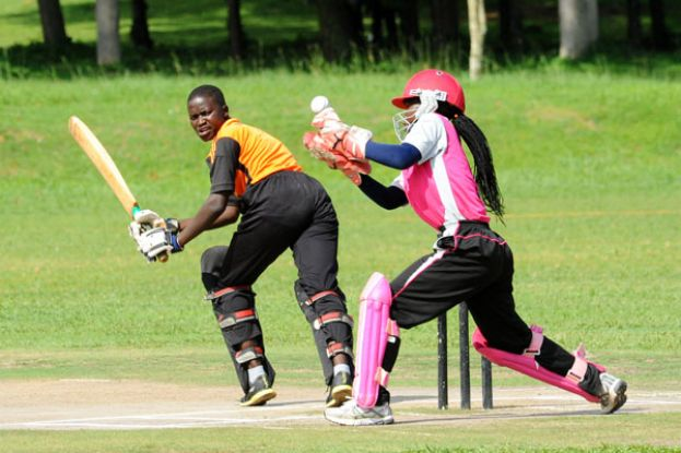 Playing smart. Olila's batter Esther Ilukor attempts to peel away for a run as Pioneer wicket-keeper keeps watch. PHOTO BY EDDIE CHICCO