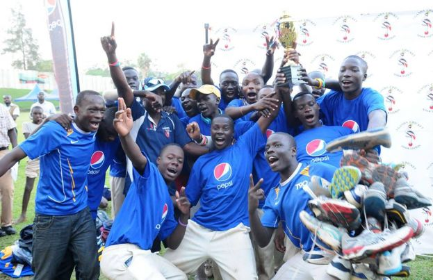 BC Mwiri Players with the Winner's Trophy during the closing ceremony of the 2015 Pepsi Schools Cricket Week.