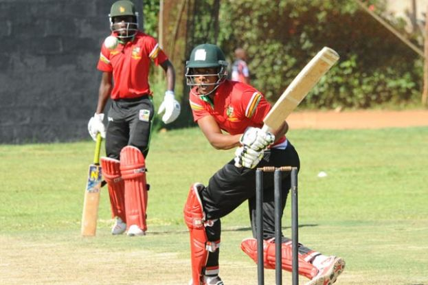 Zimbabwe international Tymcen Maruma (R) hits a boundary to the leg-side against Uganda XI enroute to a three-wicket victory on the opening day of the Quadrangular Series. The victory proved vital in Takashinga's quest to win the series. PHOTO BY EDDIE CHICCO