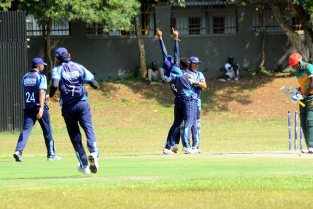Kutchi Tigers' bowler Suresh Pariyachi (hands in the air) and his teammates celebrate after danger man Roger Mukasa (R) was bowled. Photo by EDDIE CHICCO