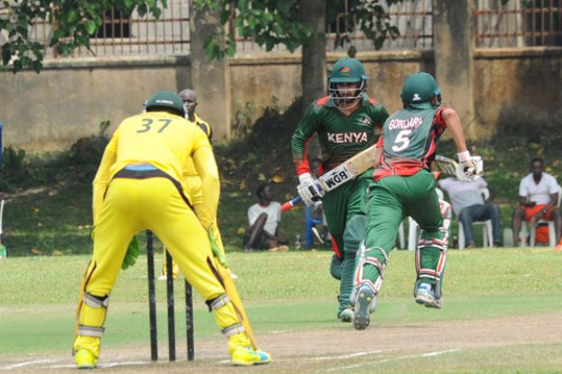 On a mission. Kenya's Irfan Karim and Dhiren Gondaria make a run during game two of the Easter Cricket Series . PHOTO BY EDDIE CHICCO