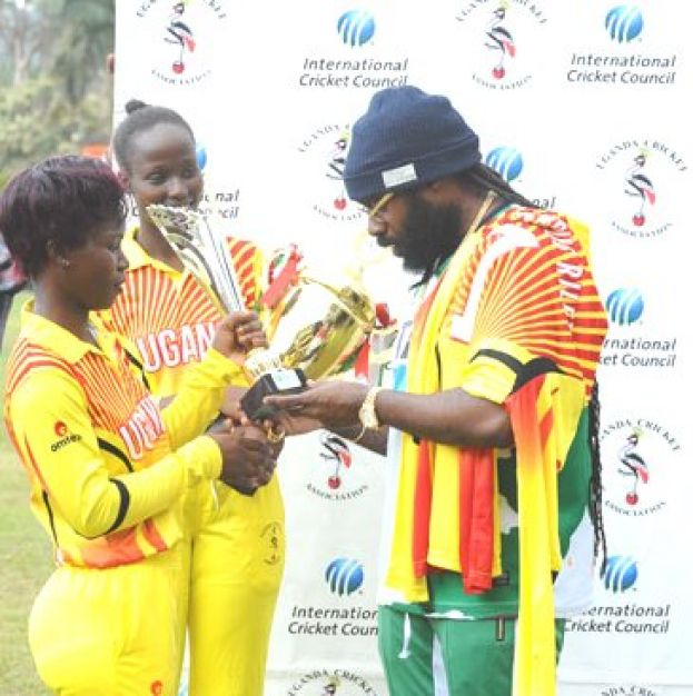 Priceless Possessions. Jamaican Reggae star Riley (R) admires trophies presented to her by the Lady Cricket Cranes skipper Kevin Awino (L) and Janet Mbabazi (C) at the end of the Tarrus Riley Cricket Carnival in Lugogo yesterday. PHOTO BY EDDIE CHICCO