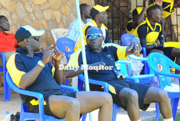 Tikolo (R) chats with Surji during his first stint as Uganda Cricket Cranes coach. PHOTO BY EDDIE CHICCO