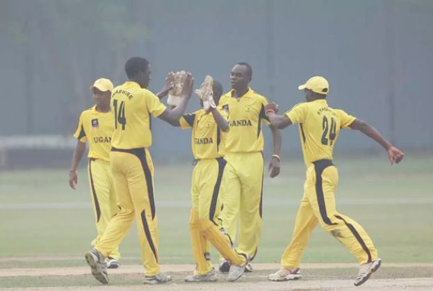 The Baby Cricket Cranes celebrate the fall of a PNG wicket yesterday. PHOTO BY ICC