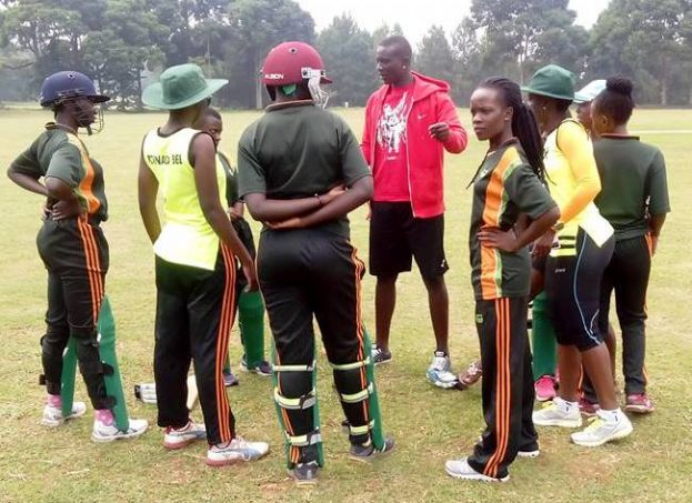 The Tornado Bee Coach ;Ogwang Jackson talking to his players during their match against Charity CC at Entebbe Oval