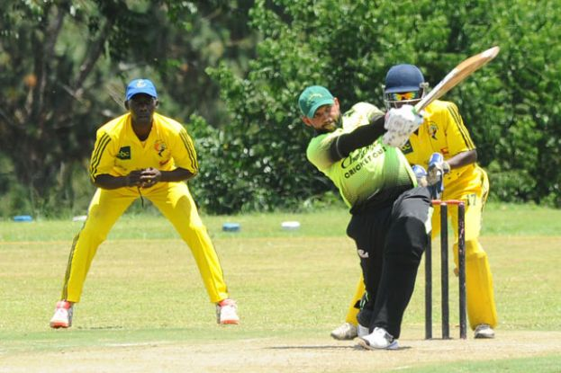 Master blaster: Challengers' heavy-hitting batsman Irfan Afridi smashing a boundary in the last encounter between his side and Aziz Damani. PHOTO BY EDDIE CHICCO