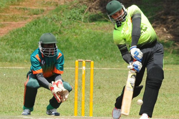 One-Man Show. Afridi (R) hits out during his breezy unbeaten knock of 94 for Challengers against Tornado Bee on Sunday at Lugogo Oval. Unfortunately it was in vain. PHOTO BY E. CHICCO