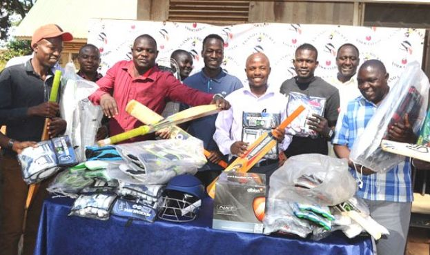 Full Protection. UCA Operations Manager Martin Ondeko (C) and Development Manager Henry Okecho (2nd R) pose with some of the teachers after giving them kits. Photo by EDDIE CHICCO