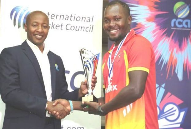 Uganda skipper Roger Mukasa receives the runners -up trophy from Rwanda Cricket Association president Eddie Balaba at Ubumwe Grande Hotel in Kigali. PHOTO BY ICC/DON MUGISHA