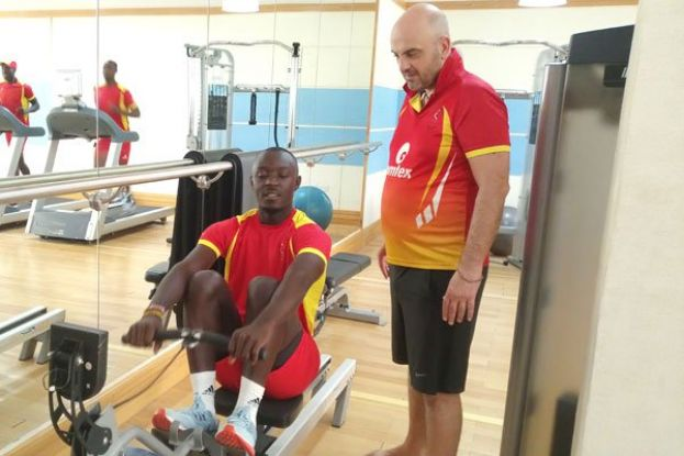 Body Strength. Cricket Cranes Performance Coach Tim Kearsey takes left arm opening bowler Charles Waiswa through a core session on the ergometer at City Seasons Hotel in Muscat, Oman yesterday. PHOTO BY INNOCENT NDAWULA