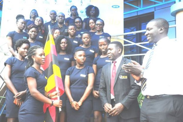 MTN Uganda's Val Okecho (R) and National Council of Sports' Katende Ssemakula (2nd R) flagged off the Lady Cricket Cranes to Netherlands for the ICC Women's World T20 Qualifier on Thursday. PHOTO BY EDDIE CHICCO